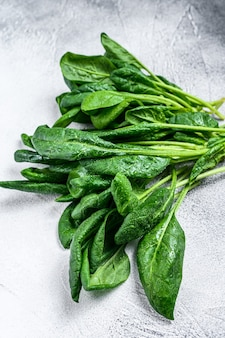 Raw fresh spinach leaves on a stone table