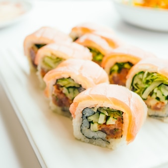 Raw fresh sushi roll with wasabi in white plate