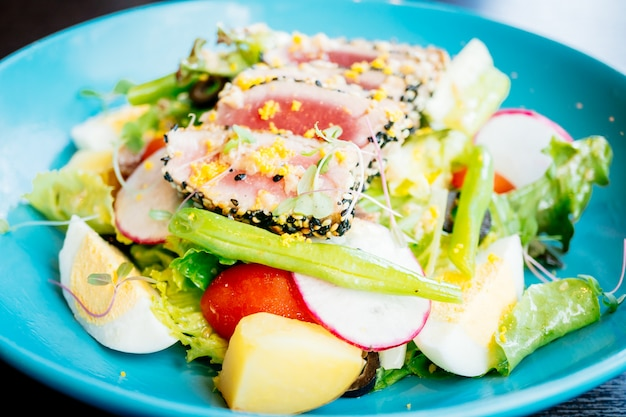 Raw and fresh tuna meat with sesame and salad