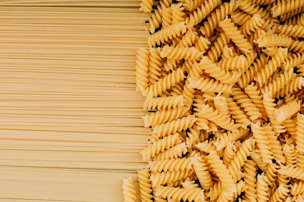 Raw fusilli and macaroni top view