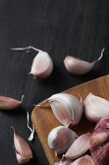 Raw garlic on cutting board