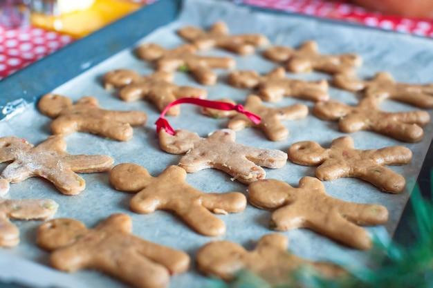 Raw gingerbread men on a baking