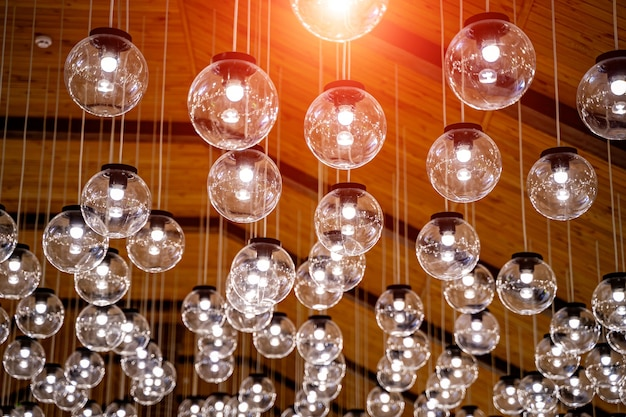 Raw of glass transparent lamps hang from the celling. design interior.