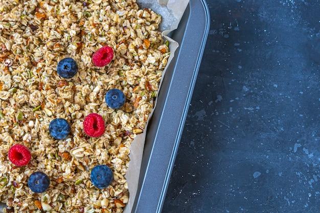 Raw granola, muesli from oat flakes, varius of nuts