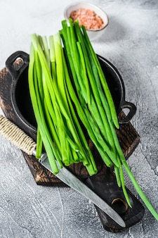 Raw green onions chives. white background. top view.