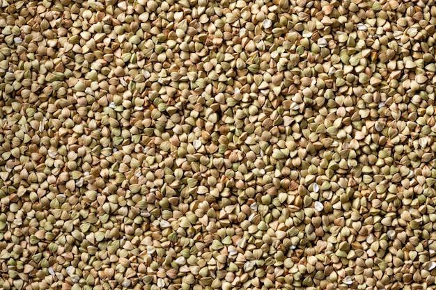 Сырая зеленая необработанная текстура зерна гречихи