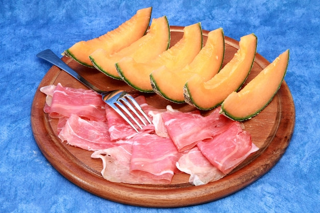 Raw ham and melon slices