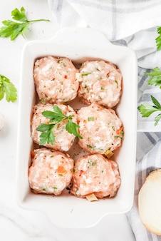 Raw homemade chicken or turkey meatballs