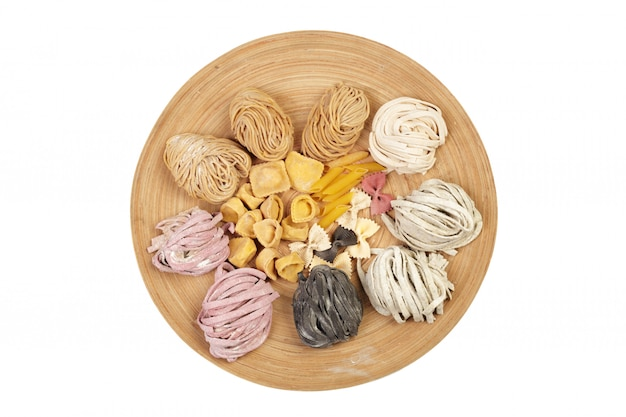 Raw homemade pasta, variety of types and shapes of dry italian pasta