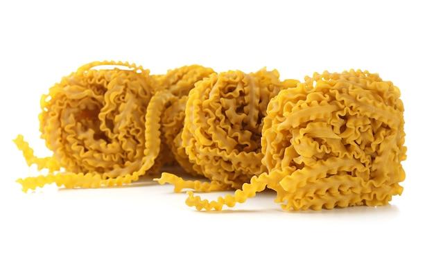 Raw homemade pasta, on white