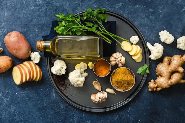 Raw ingredients cooking aloo gobi indian food