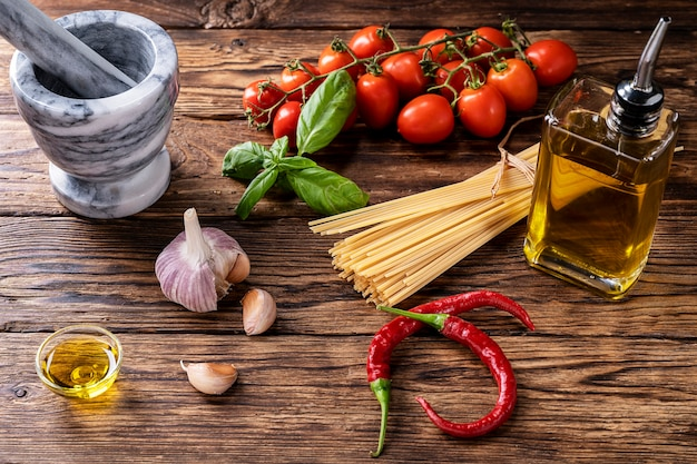 Raw ingredients for cooking italian pasta with tomatoes