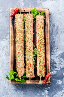 Raw kebabs in skewers