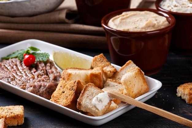 Raw kibbeh, toast with syrian curd.
