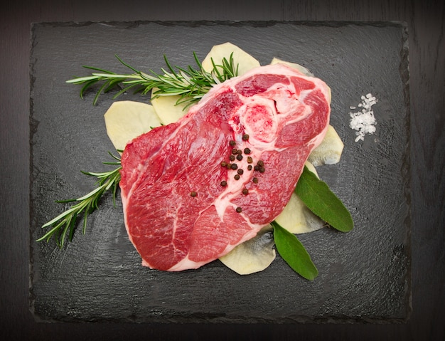 Raw lamb with potatoes and rosemary and sage
