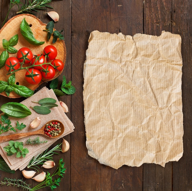 Raw lasagna pasta, vegetables and herbs on a wooden background