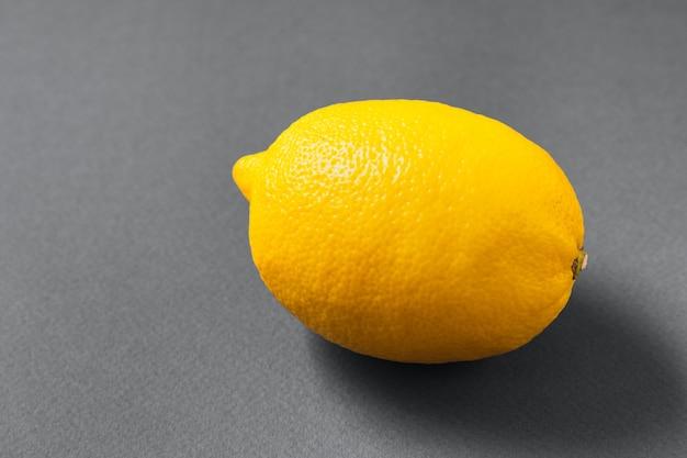 Raw lemon fruit on trendy ultimate gray table,flat lay.