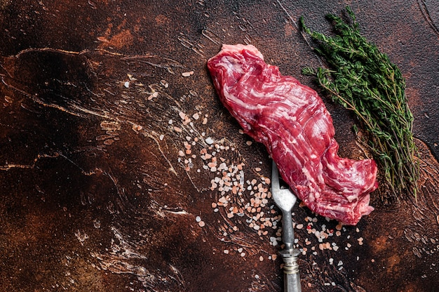 Raw machete skirt beef steak on meat fork