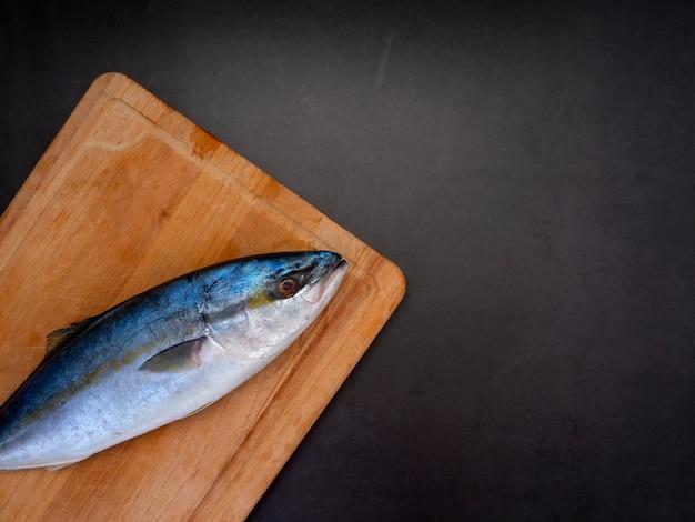 Raw mackerel on a kitchen cutting board