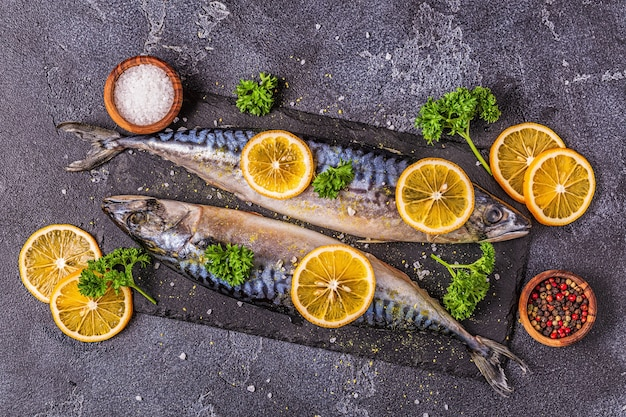 Raw mackerel with spices on the board, top view