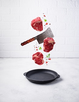 Raw marbled ribeye steak. food levitation