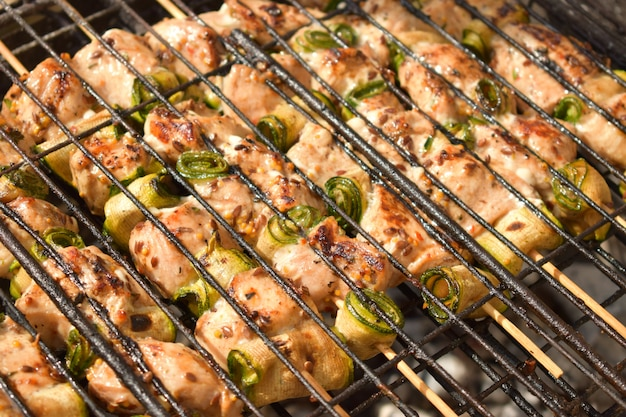 Raw marinated chicken meat skewers.