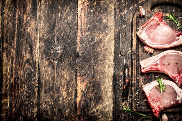 Raw meat background. raw pork with spices .