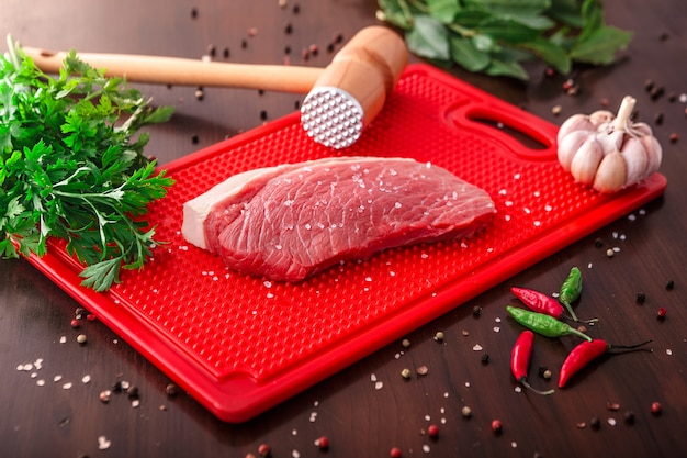 Raw meat selection on wooden cutting board