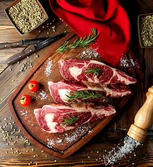 Raw meat slices topped with herbs and salt