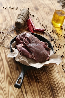 Raw meat with ingredients for cooking meal