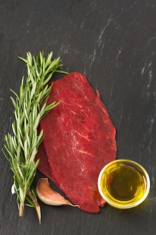 Raw meat with oil