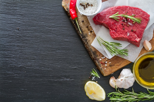 Raw meat on wood background