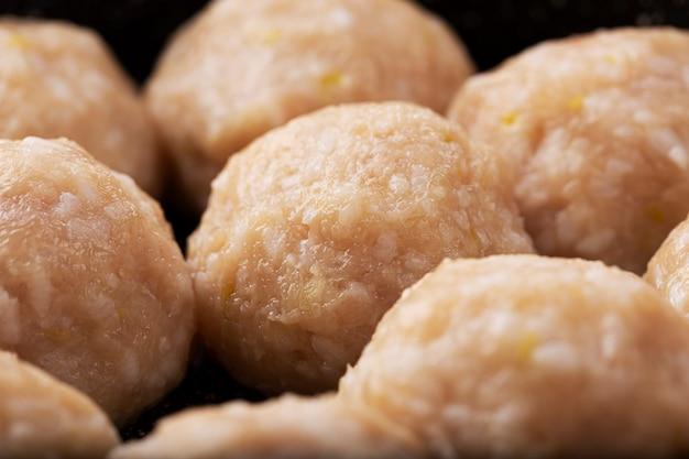 Raw meatballs closeup. home cooking concept