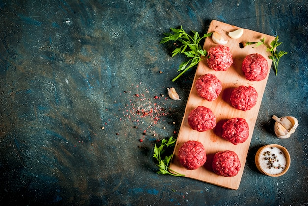 Raw meatballs with olive oil and spices for ccoking