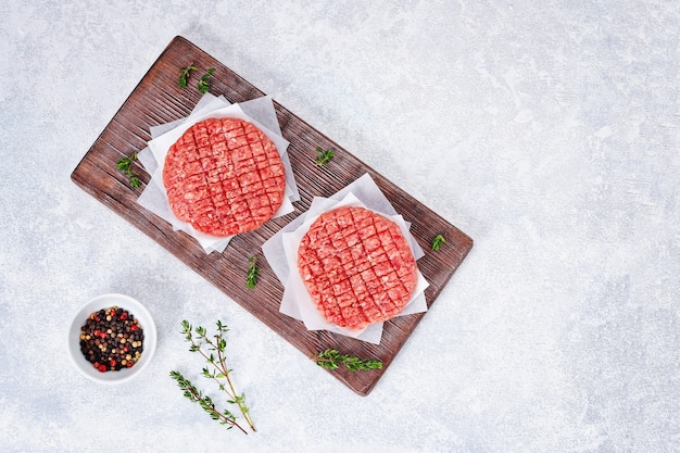 Raw minced beef patties for burgers beef cutlets