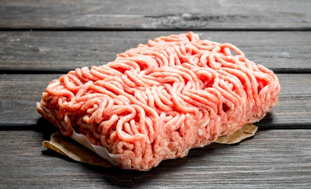 Raw minced beef. on a wooden background.