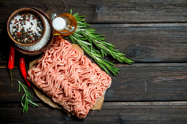 Raw minced meat with spices and herbs .