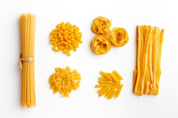 Raw mix of pasta on white background