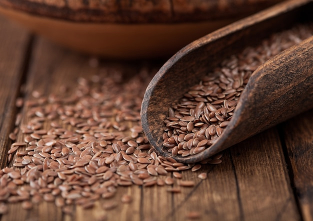 Raw natural organic linseed flax seed in wooden spoon