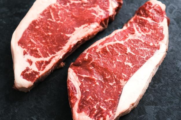 Raw new york striploin beef steak isolated on black