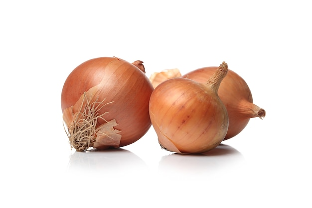 Raw onions on a white surface