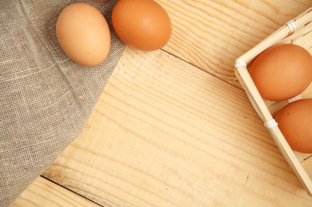 Raw organic brown eggs in a basket