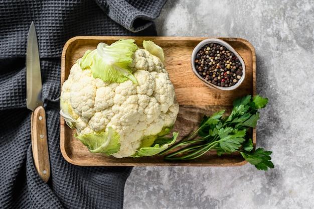 Raw organic cauliflower with leaves