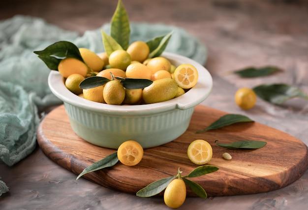 Raw organic orange kumquats in a bowl