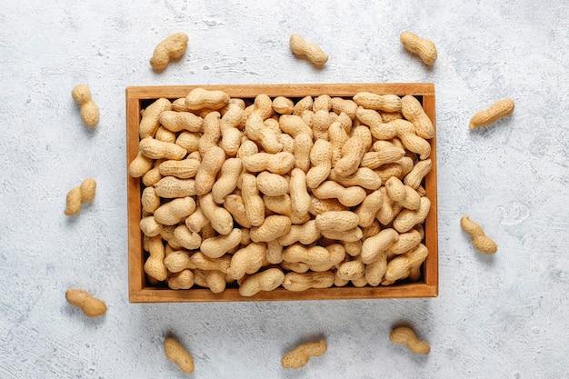 Raw organic peanuts in shell.