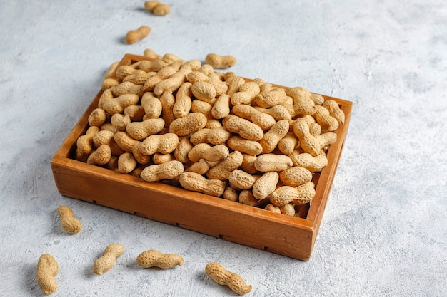 Raw organic peanuts in shell.