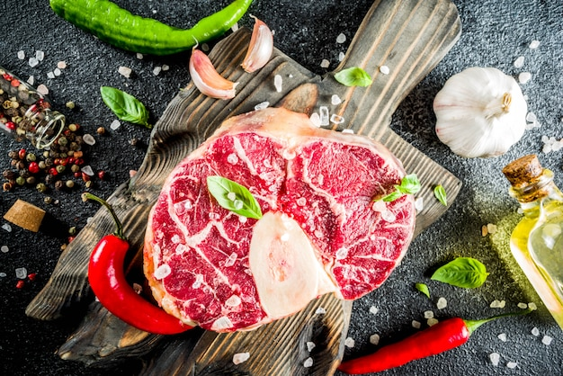 Raw ossobuco beef steak with spices