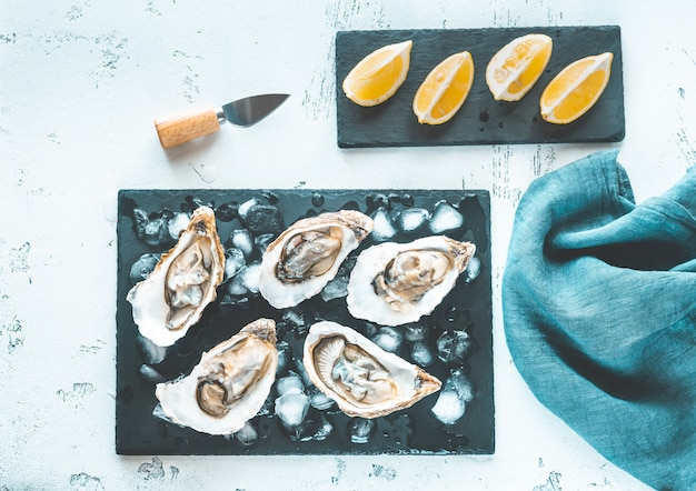 Raw oysters on the slate board