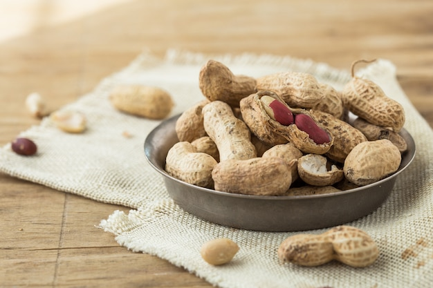 Raw peanuts. vegetarian food. gray background. top view. space for text