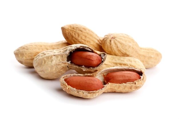 Raw peanuts on white background. healthy snack ona white background. top view. close-up.